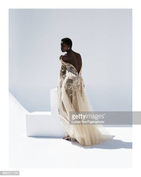 Model Maria Borges poses at a fashion shoot for Madame Figaro on July 8 2017 in Paris France Dress Resonances haute joaillerie Makeup by L'Oreal...