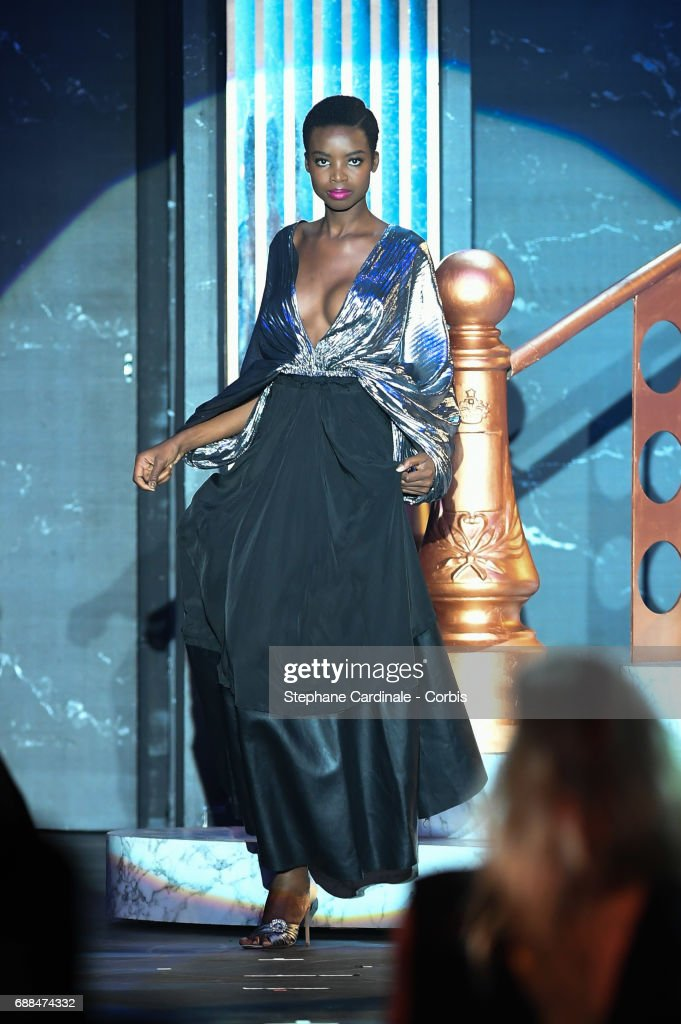 Model Maria Borges walks the runway during the amfAR Gala Cannes 2017 at Hotel du Cap-Eden-Roc on May 25, 2017 in Cap d'Antibes, France.
