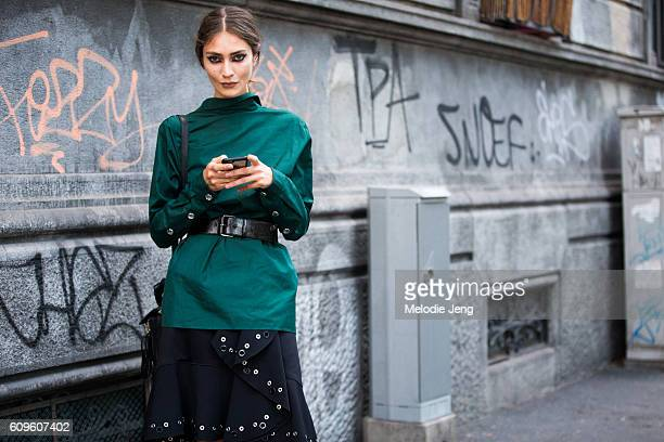 Model Marine Deleeuw wears a N21 shirt backwards outside the N21 show during Milan Fashion Week Spring/Summer 2017 on September 21 2016 in Milan Italy