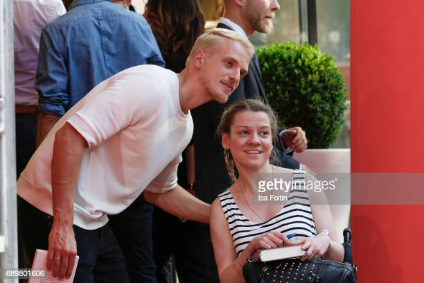 Model Mario Galla with a fan attend the 'Global Gladiators' exclusive preview at Astor Film Lounge on May 29 2017 in Berlin Germany