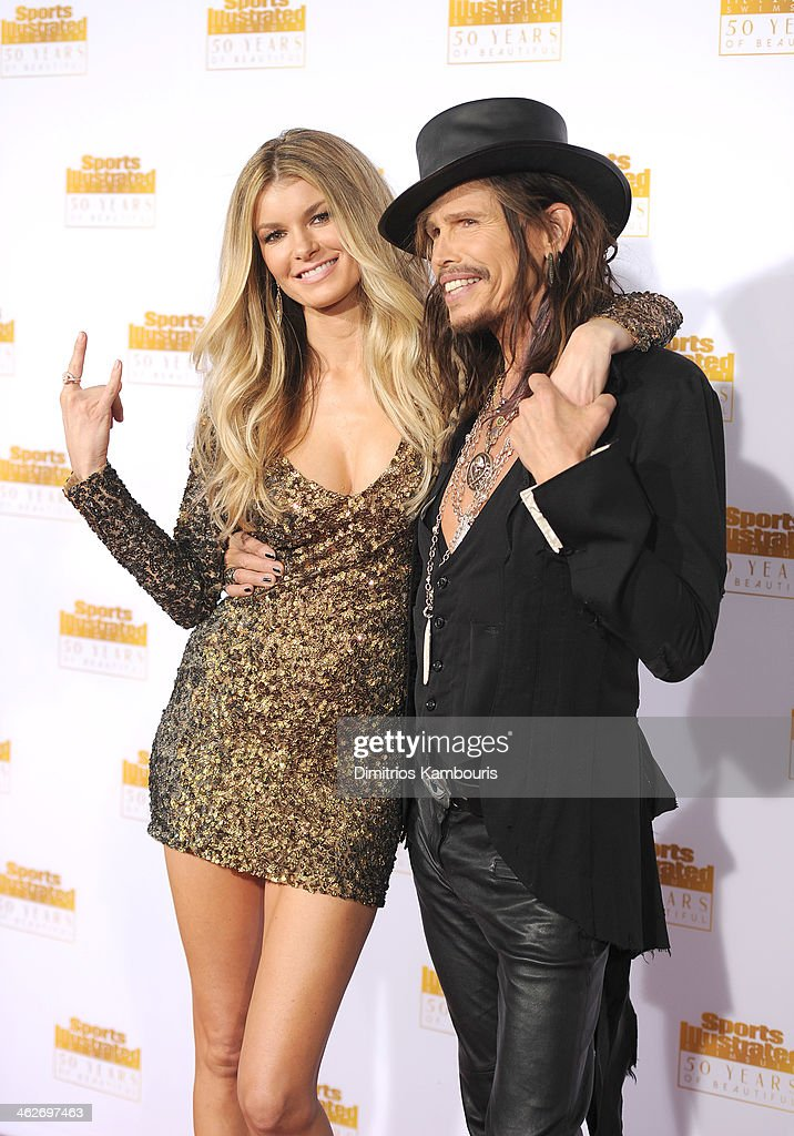 Model Marisa Miller (L) and musician Steven Tyler of Aerosmith attends NBC and Time Inc. celebrate the 50th anniversary of the Sports Illustrated Swimsuit Issue at Dolby Theatre on January 14, 2014 in Hollywood, California.
