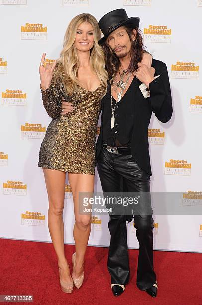 Model Marisa Miller and singer Steven Tyler arrive at NBC And Time Inc Celebrate 50th Anniversary Of Sports Illustrated Swimsuit Issue at Dolby...