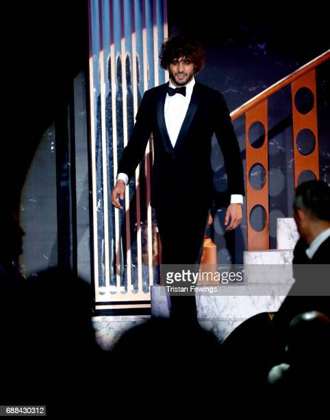 Model Marlon Teixeira walks the runway during the amfAR Gala Cannes 2017 at Hotel du CapEdenRoc on May 25 2017 in Cap d'Antibes France