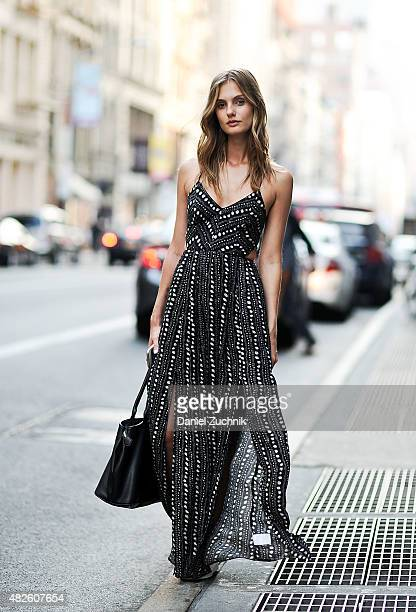 Model Marta Bez is seen in Soho wearing an Urban Outfitters dress Adidas sneakers and a Vivienne Westwood bag on July 31 2015 in New York City