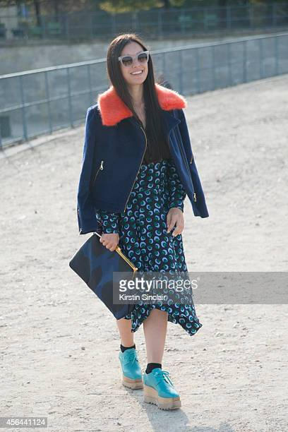 Model Marta Pozzan is wearing a Shrimp coat Stella McCartney bag and dress and Spektre sunglasses on day 7 of Paris Collections Women on September 29...