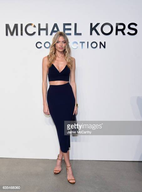 Model Martha Hunt attends the Michael Kors Collection Fall 2017 runway show at Spring Studios on February 15 2017 in New York City