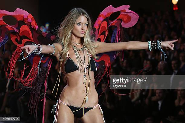 Model Martha Hunt walks the runway during the 2015 Victoria's Secret Fashion Show at Lexington Avenue Armory on November 10 2015 in New York City
