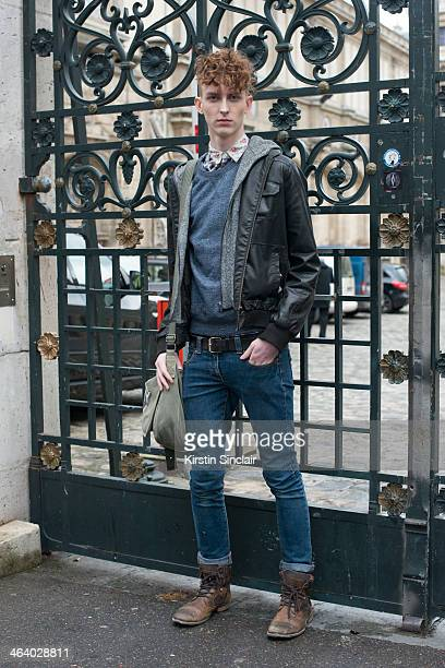 Model Matthew Johnstone wears River Island boots Topman shirt and Burton jeans and sweater day 5 of Paris Mens Fashion Week Autumn/Winter 2014 on...