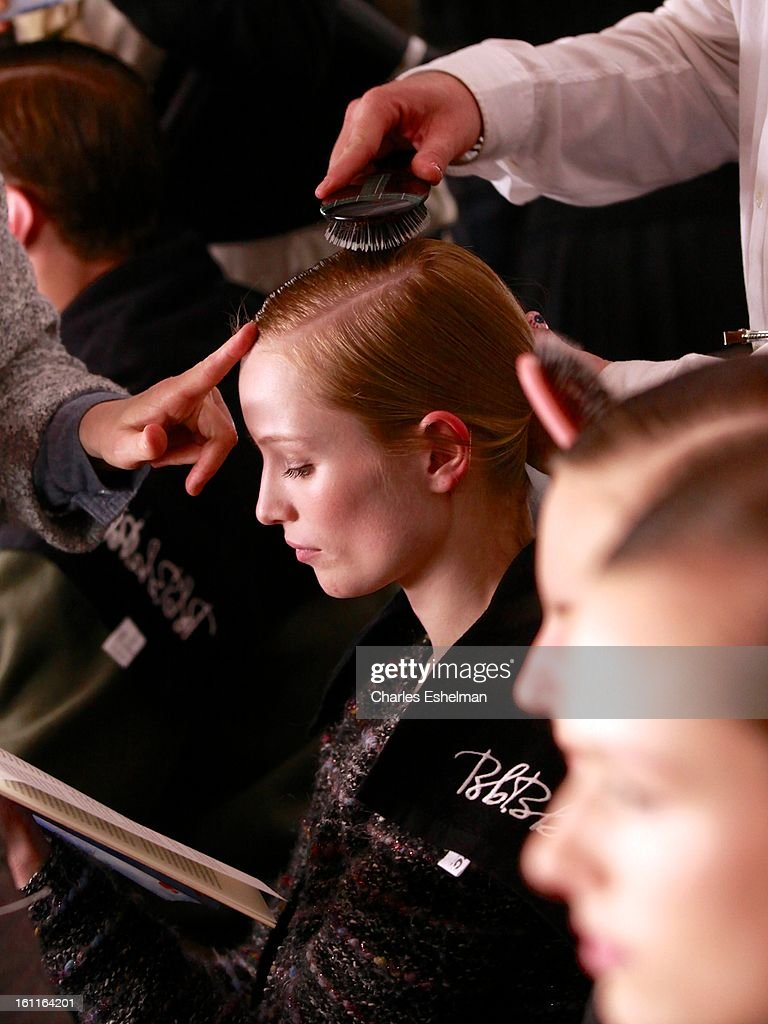 Model Maud Welzen backstage prepares backstage at the Lacoste Fall 2013 Mercedes-Benz Fashion Show at The Theater at Lincoln Center on February 9, 2013 in New York City.