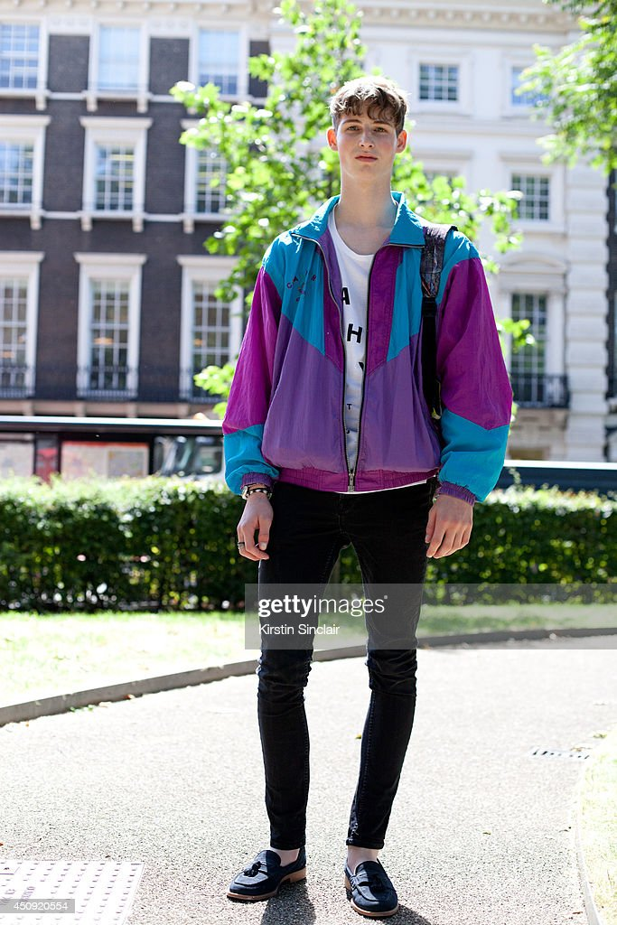 Model Max Streetley wears a Topman Vintage jacket, Topman trousers, Russell and Bromley shoes, Hype bag and Boxpark Vintage t-shirt on day 3 of London Collections: Men on June 17, 2014 in London, England.