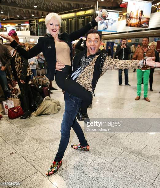 Model Melanie Mueller poses with fashion designer Julian F M Stoeckel before the flight to Australia as a participant in the 2014 RTLTVShow...