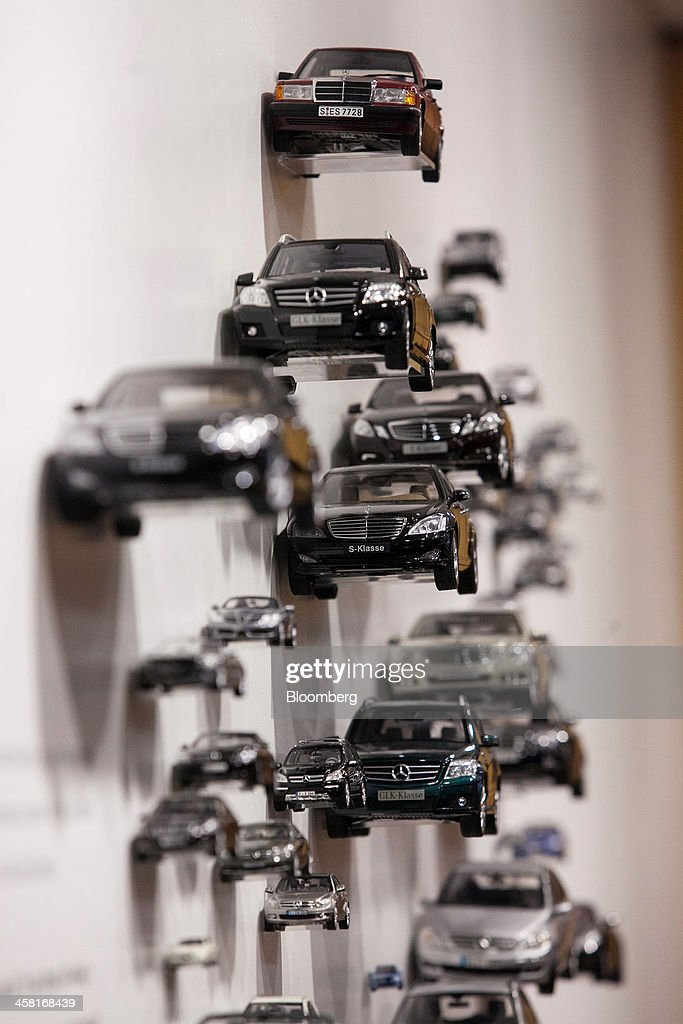 Model Mercedes-Benz cars sit on display inside the company's showroom in Berlin, Germany, on Thursday, Dec. 19, 2013. European new-car sales rose a third consecutive month in November, the longest period of gains in four years. Photographer: Krisztian Bocsi/Bloomberg via Getty Images