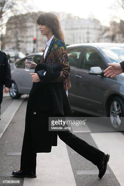 Model Mica Arganaraz exits the Dries Van Noten show at Hotel de Ville in a Dries Van Noten jacket on Day 2 of Paris Fashion Week FW15 March 4 2015 in...