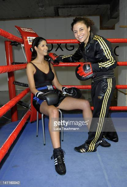 Model Micaela Schaefer and Susi Kentikian train for a tv celebrity boxing show at the Box Gym Koepenick on March 11 2012 in Berlin Germany