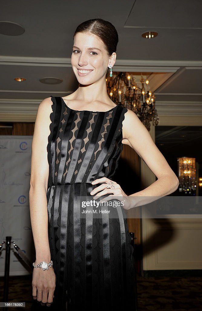 Model Michelle Box seen wearing an Oscar de la Renta black evening gown at the 25th annual Colleagues Luncheon at the Beverly Wilshire Hotel on April 9, 2013 in Beverly Hills, California.