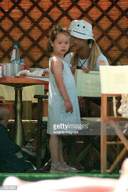 Model Michelle Hunziker the wife of Italian pop star Eros Ramazzotti spends the day with her daughter Aurora at a beach July 2 2001 in Milan