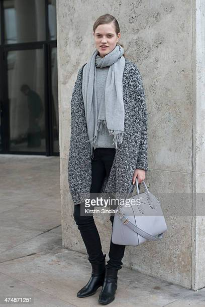 Model Milana Kruz wears a Givenchy bag Rag and Bone sweater and scarf Zadig and Voltaire coat H and M jeans on day 1 of Paris Collections Women on...