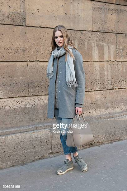 Model Milana Kruz wears an Eleven Paris coat Rag and Bone scarf Zara jeans Miu Miu shoes and a Givenchy bag on day 2 of Paris Haute Couture Fashion...