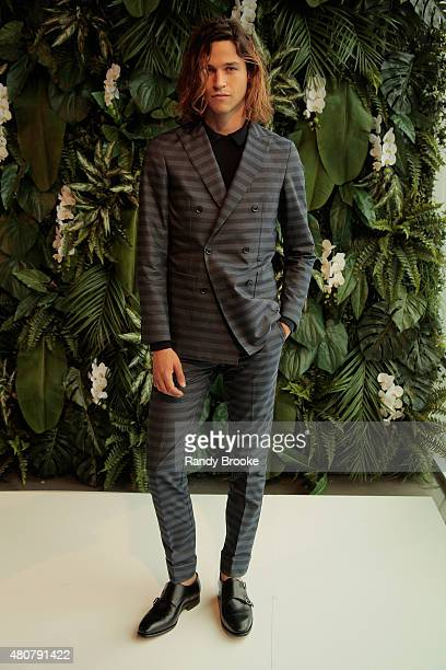 Model Miles McMillan poses on the runway at the Tommy Hilfiger Spring 2016 Men's Tailored Collection presentation on July 15 2015 in New York City