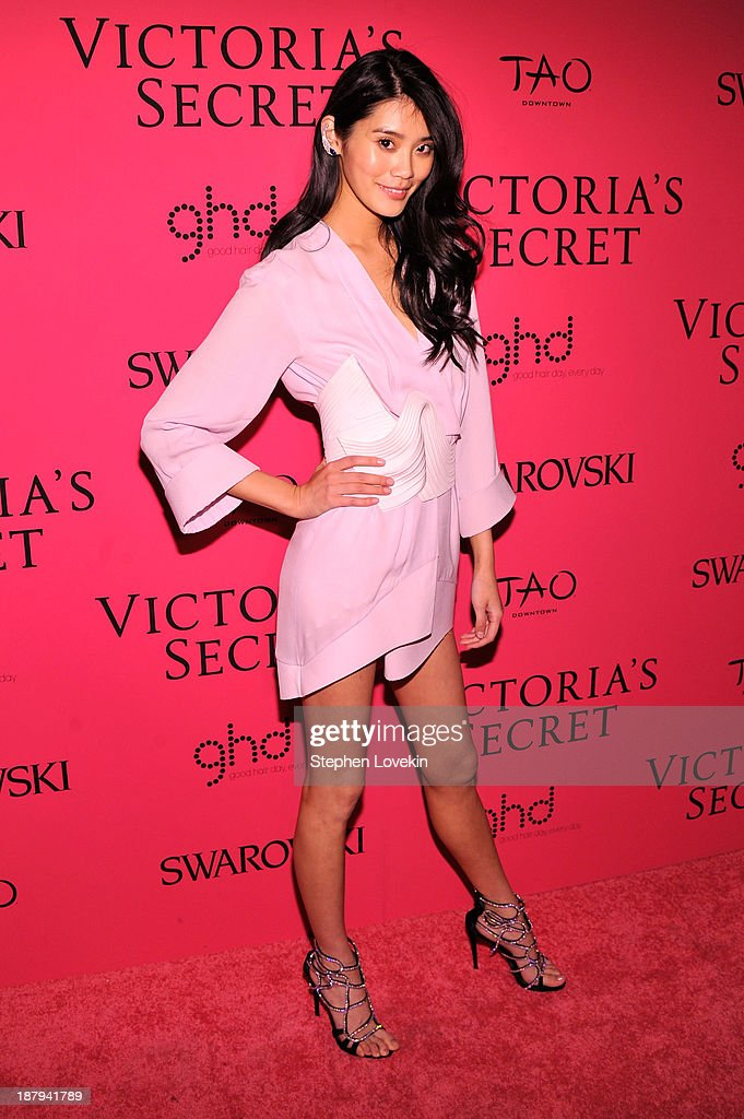 Model Ming Xi attends the 2013 Victoria's Secret Fashion Show at TAO Downtown on November 13, 2013 in New York City.