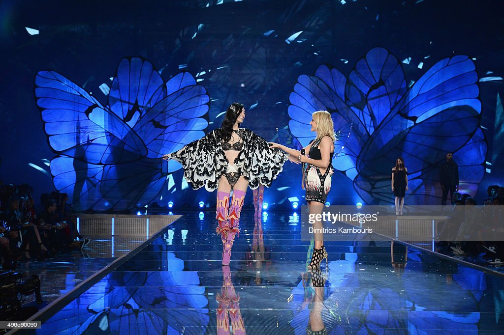 Model Ming Xi from China walks the runway while singer Ellie Goulding performs during the 2015 Victoria's Secret Fashion Show at Lexington Avenue Armory on November 10, 2015 in New York City.