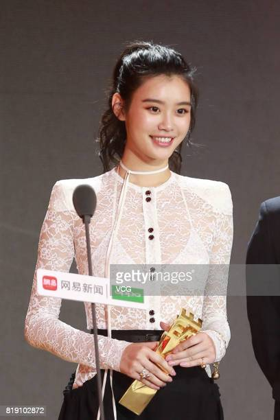Model Ming Xi Mengyao poses with her trophy during the 2017 NetEase Entertainment Ceremony on July 19 2017 in Beijing China