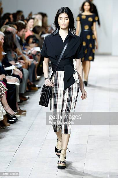 Model Ming Xi walks the runway at the Michael Kors fashion show during MercedesBenz Fashion Week Spring 2015 at Spring Studios on September 10 2014...