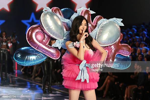 Model Ming Xi walks the runway during the 2015 Victoria's Secret Fashion Show at Lexington Avenue Armory on November 10 2015 in New York City