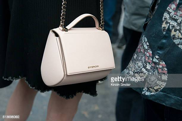 Model Ming Xi wears a Givenchy bag on day 3 during Paris Fashion Week Autumn/Winter 2016/17 on March 3 2016 in Paris France