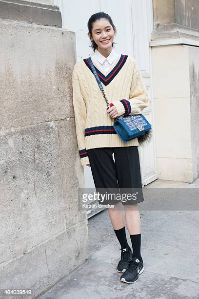Model Ming Xi wears a vintage Ralph Lauren jumper Chanel bag Dolce and Gabbana shirt and shorts and Nike trainers day 5 of Paris Mens Fashion Week...