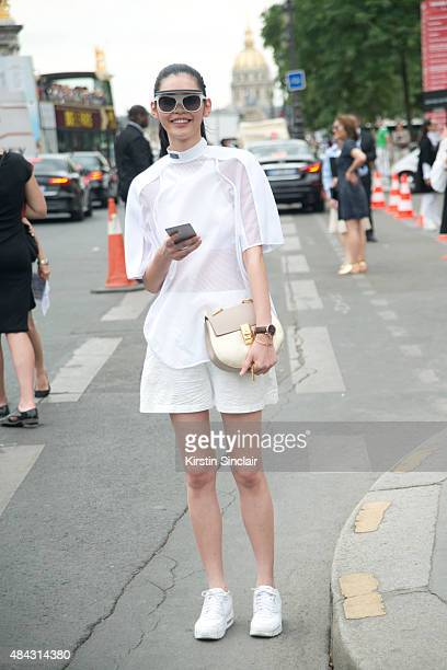 Model Ming Xi wears an Alexander Wang top and shorts with a Chloe bag and Nike trainers on day 3 of Paris Fashion Week Haute Couture Autumn/Winter...