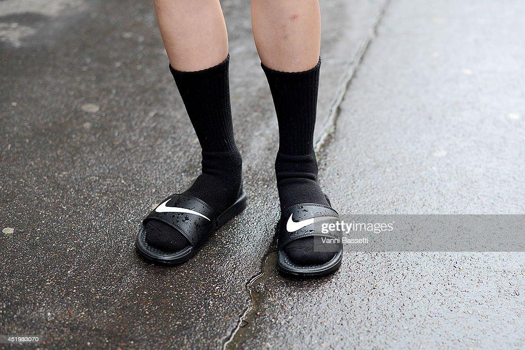 Model Ming Xi wears Nike slides after Vionnet show after the Vionnet show on July 9 2014 in Paris France