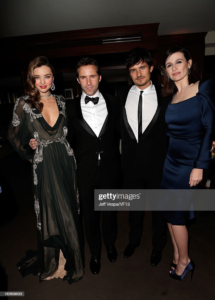 Model Miranda Kerr, actors Alessandro Nivola, Orlando Bloom, and actress Emily Mortimer attend the 2013 Vanity Fair Oscar Party hosted by Graydon Carter at Sunset Tower on February 24, 2013 in West Hollywood, California.