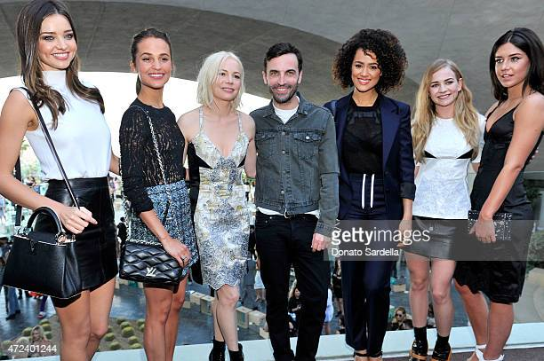 Model Miranda Kerr actresses Alicia Vikander and Michelle Williams designer Nicolas Ghesquiere and actresses Nathalie Emmanuel Britt Robertson and...