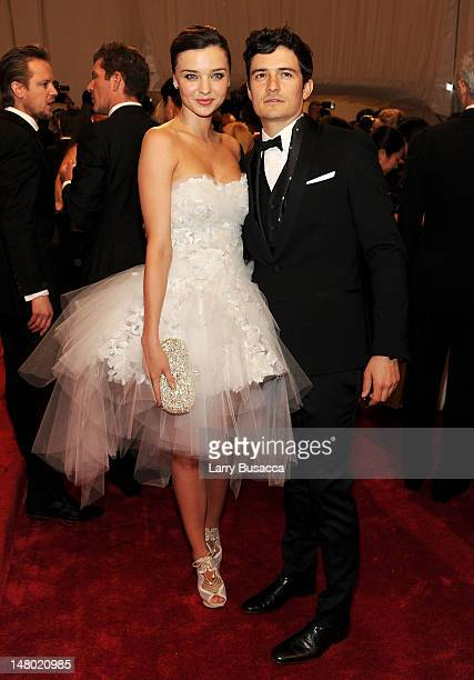 Model Miranda Kerr and actor Orlando Bloom attend the 'Alexander McQueen Savage Beauty' Costume Institute Gala at The Metropolitan Museum of Art on...