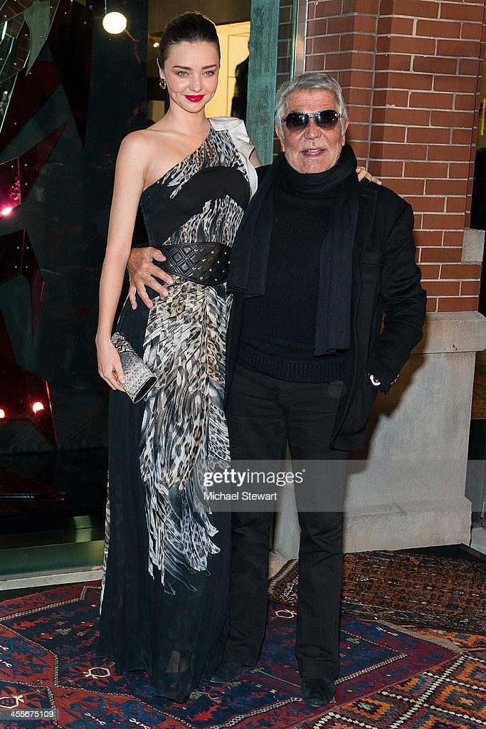 Model Miranda Kerr and designer Roberto Cavalli attend the Just Cavalli Soho Flagship store opening at Just Cavalli Soho on December 12 2013 in New...