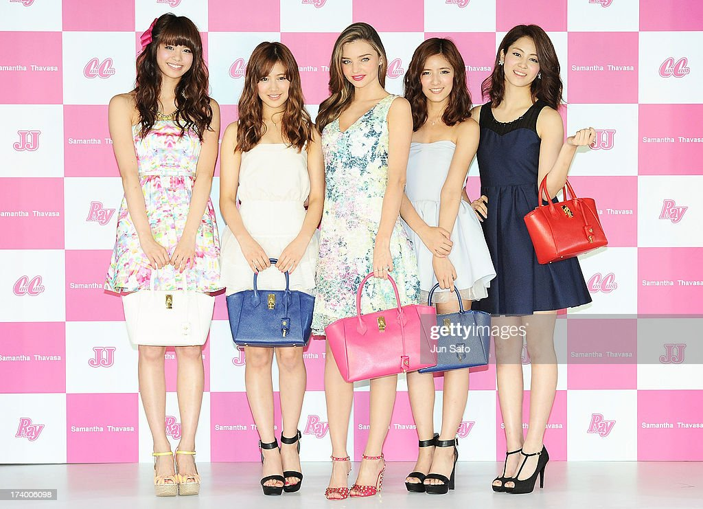 Model Miranda Kerr (center) and members of E-girls attend a press conference during the Samantha Thavasa Ladies Tournament at Eagle Point Golf Club on July 19, 2013 in Ami, Ibaraki, Japan.