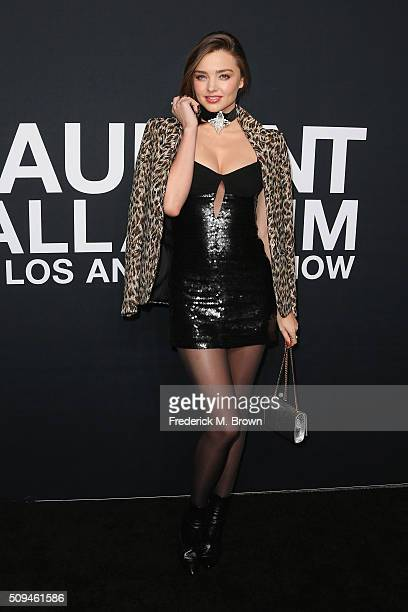 Model Miranda Kerr attends the Saint Laurent show at The Hollywood Palladium on February 10 2016 in Los Angeles California