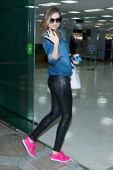 Model Miranda Kerr is seen on departure at Gimpo International Airport on April 1 2014 in Seoul South Korea