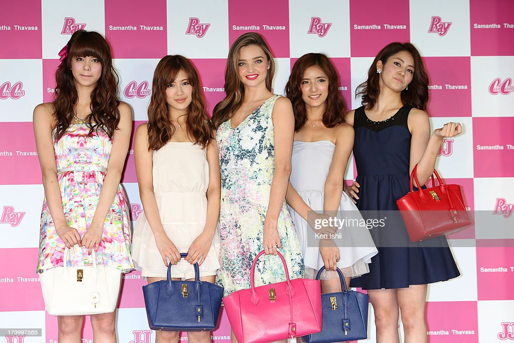 Model Miranda Kerr (C) poses with Japanese models as she attends the Samantha Thavasa Ladies Tournament at Eagle Point Golf Club on July 19, 2013 in Ami, Ibaraki, Japan.