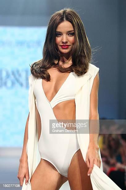 Model Miranda Kerr showcases designs by Carla Zampatti during the David Jones S/S 2012/13 Season Launch at David Jones Castlereagh Street on August...