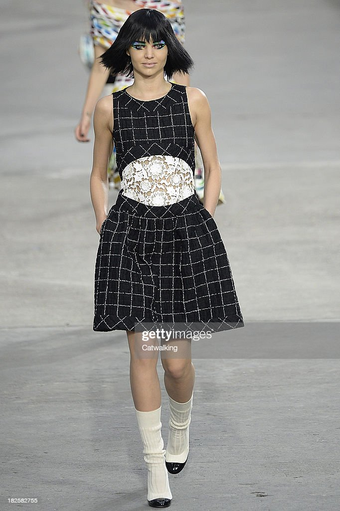 Model Miranda Kerr walks the runway at the Chanel Spring Summer 2014 fashion show during Paris Fashion Week on October 1, 2013 in Paris, France.