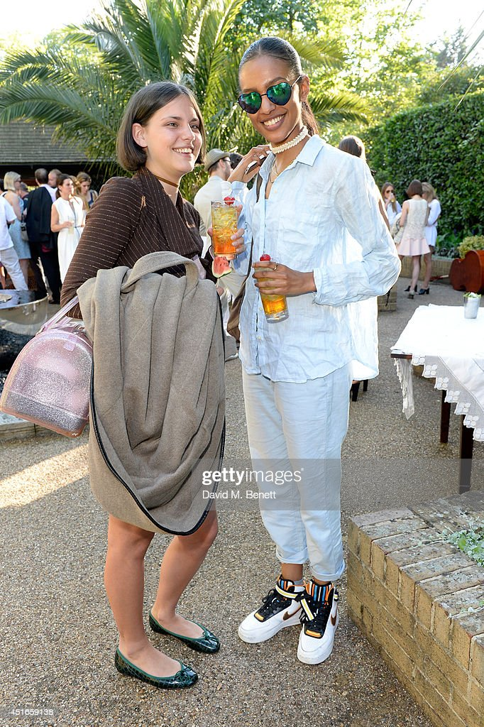 Model Moffy (L) and guest attend the Club Monaco Garden Party hosted by Quentin Jones, Clara Paget and Annie Morris in Eaton Square on July 3, 2014 in London, England.