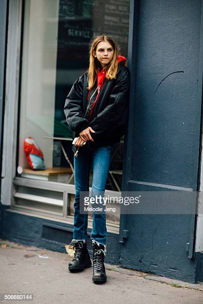 Model Molly Bair wears a black bomber jacket and combat boots on January 24 2016 in Paris France