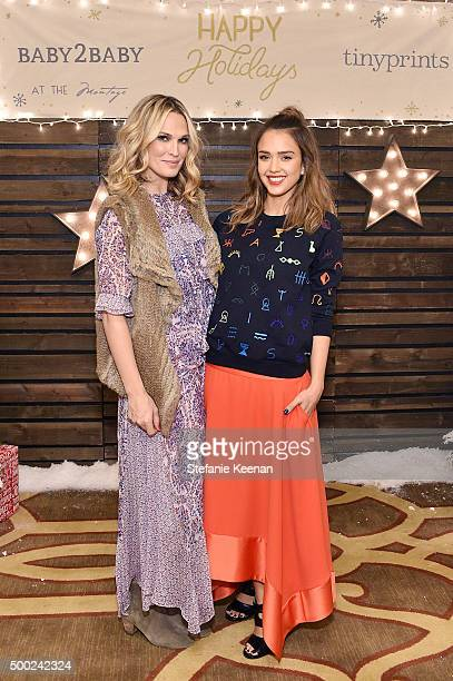 Model Molly Sims and actress Jessica Alba attend the Baby2Baby Holiday Party Presented By Tiny Prints At Montage Beverly Hills on December 6 2015 in...