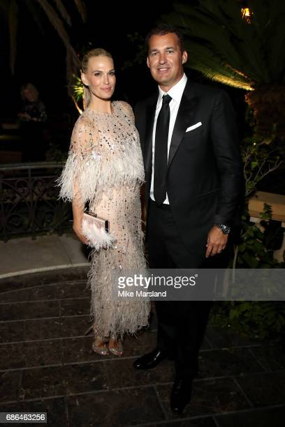 Model Molly Sims and producer Scott Stuber attend the Netflix party during the 70th annual Cannes Film Festival at on May 21 2017 in Cannes France