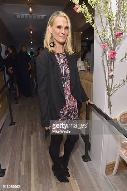 Model Molly Sims attends the grand opening of Au Fudge presented by Amazon Family on March 1 2016 in West Hollywood California