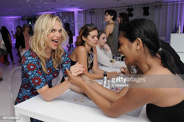 Model Molly Sims attends the Philips Sonicare DiamondClean Amethyst launch on July 21 2015 in New York City