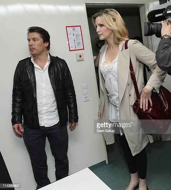 Model Nadja Auermann and her former husband Wolfram Grandezka arrive in court to face charges of income tax evasion on May 19 2011 in Berlin Germany...