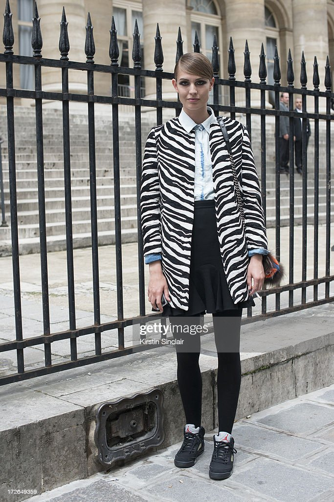 Model Nadja Bender wears a Chanel bag, Carven skirt, Nike trainers, Zara shirt and Jacket on day 3 of Paris Collections: Womens Haute Couture on July 03, 2013 in Paris, France.